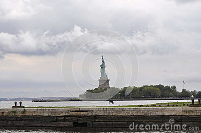 New York City,August 2nd:Statue of Liberty island on a dramatic sky in New York City