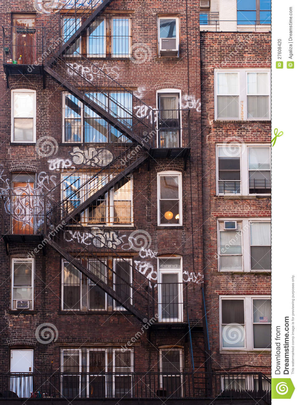 an old brick apartment building in manhattan is covered with graffiti