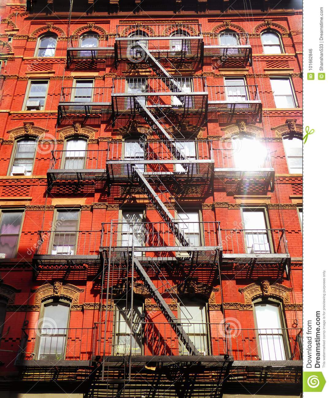 Cheap Apartments Outside Bricks: New York City Fire Escape Ladder Stock Photo