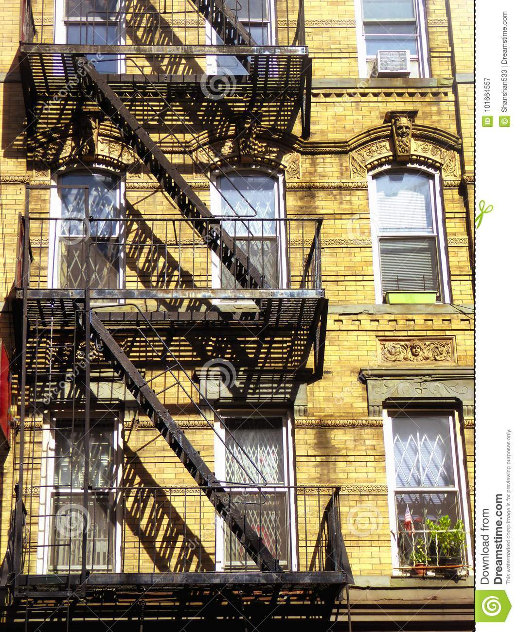 New York Apartments Outside: New York City Fire Escape Ladder Stock Image