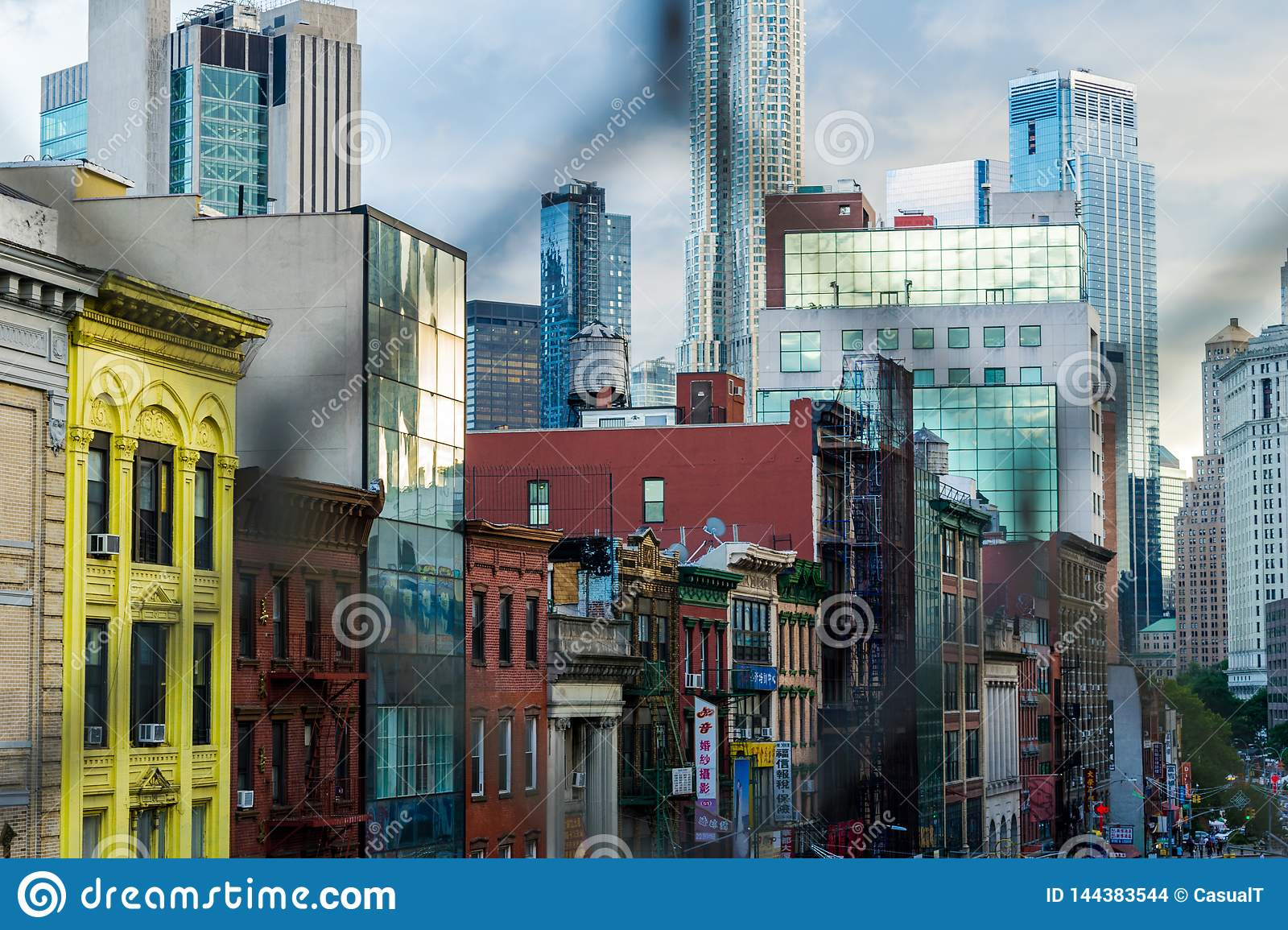 New York City, NY / USA - 08/01/2018: Buildings along East Broadway, in New York City`s Chinatown district, Downtown