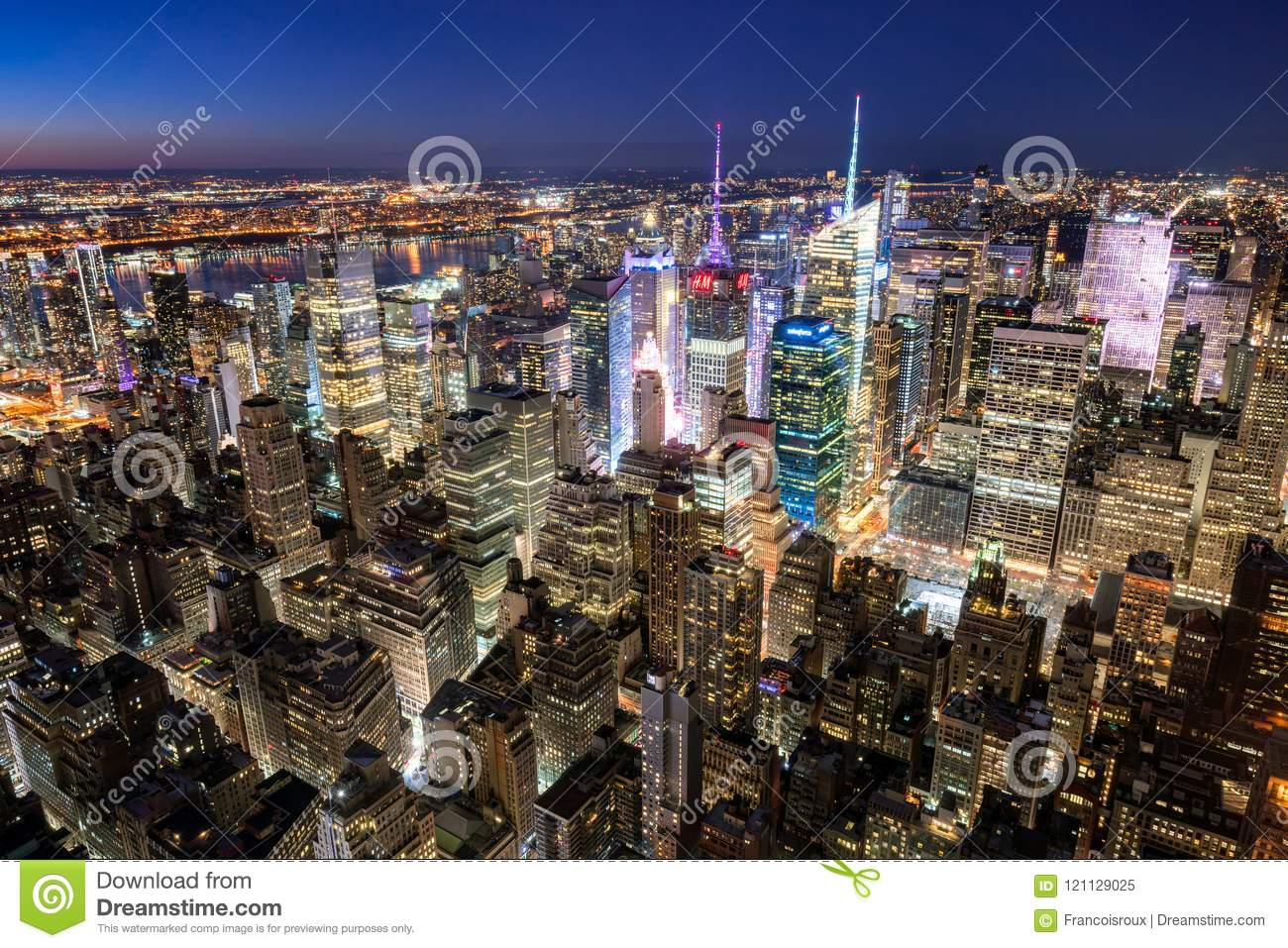 Manhattan skyscrapers at night Times Square. The view includes The New York Times Tower, Rockefeller Center. New York City