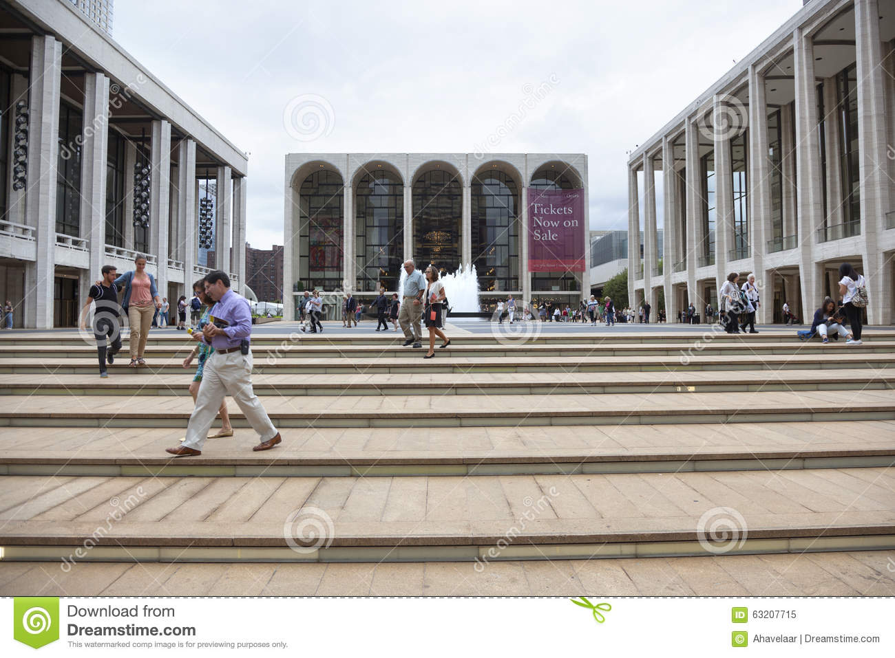 new york city, 12 september 2015: people walk on steps near metropolitan opera at lincoln centre in new york city