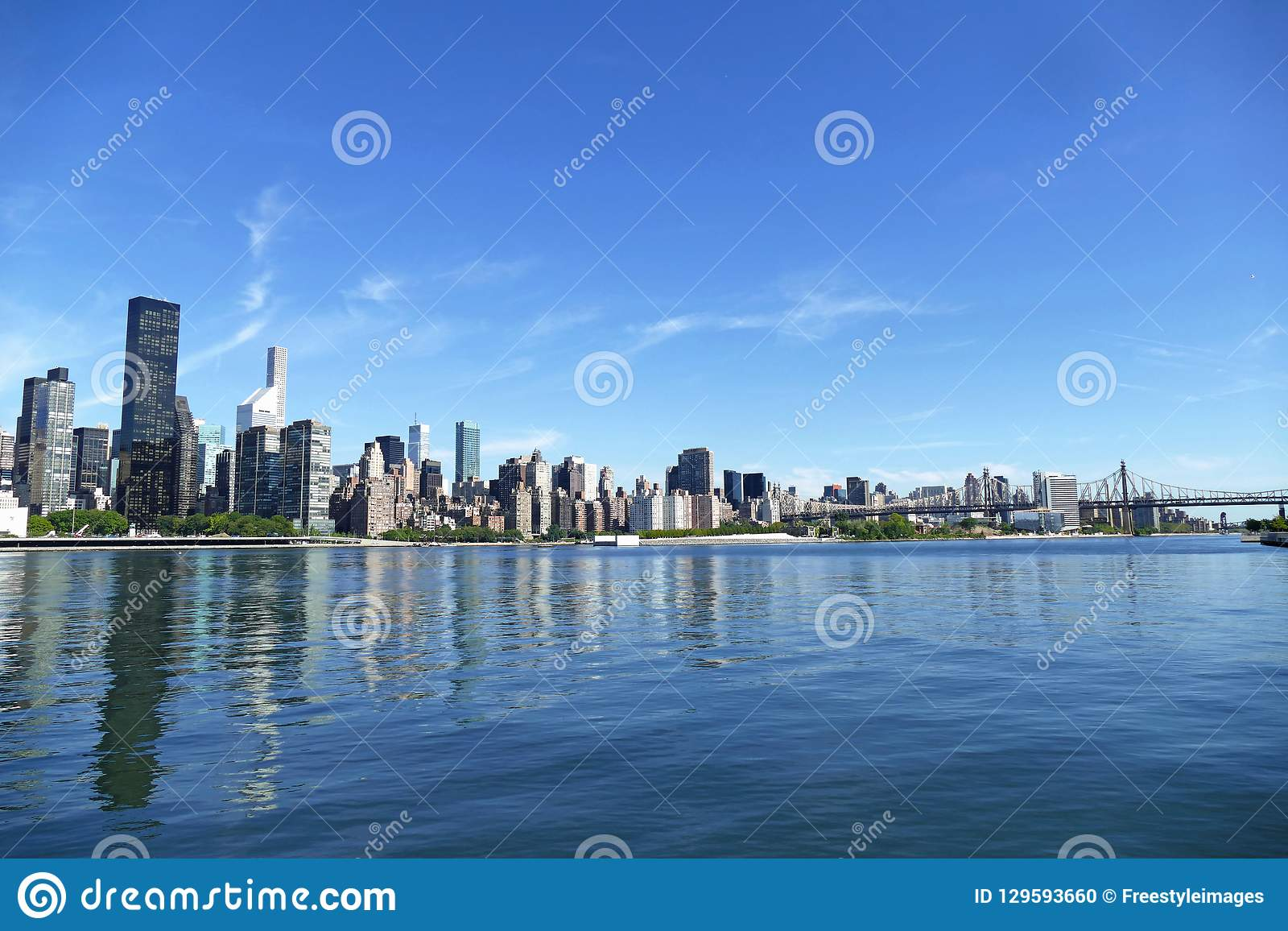 New York City Skyline, East River and Manhattan, New York waterfront with Queensboro Bridge in background