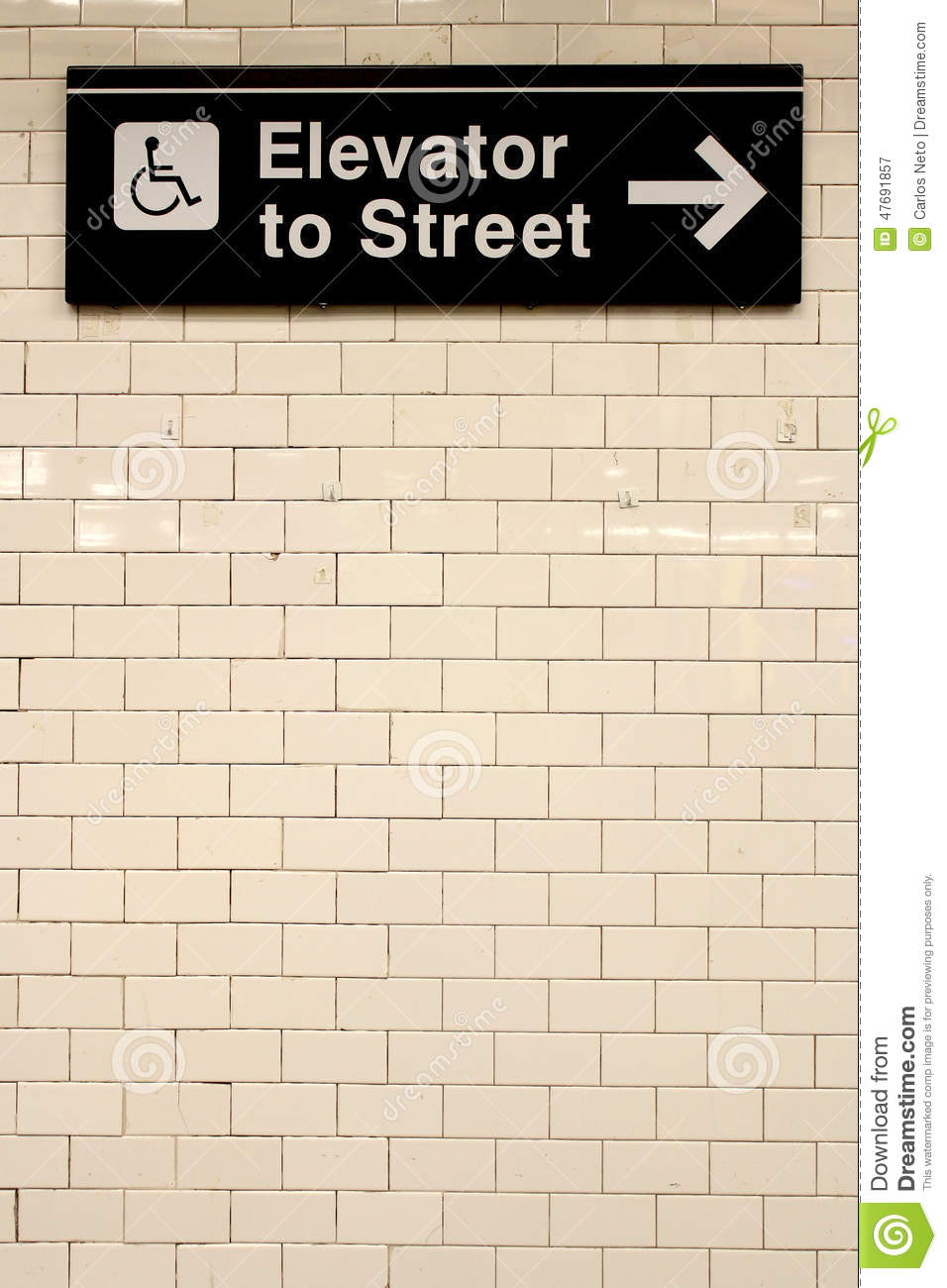 new york city station subway directional sign on tile wall
