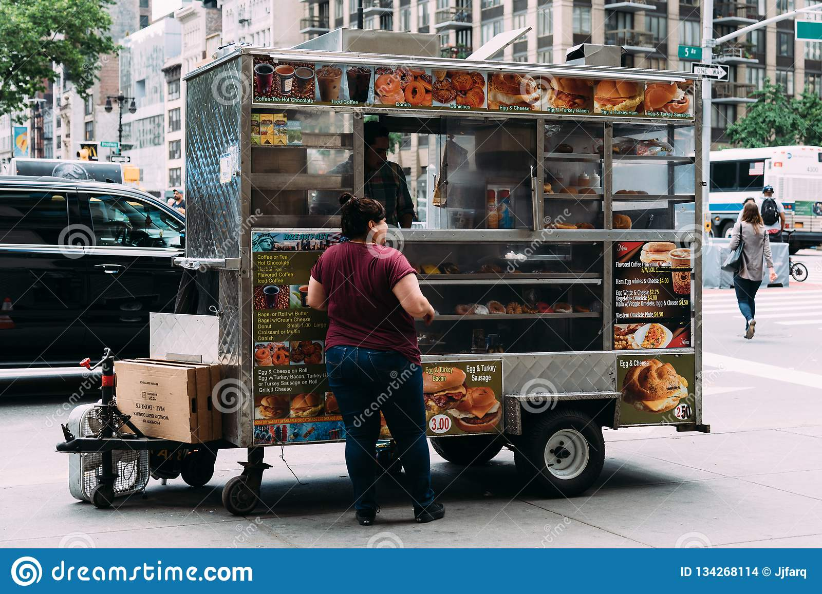 Woman is buying food at food truck in New York