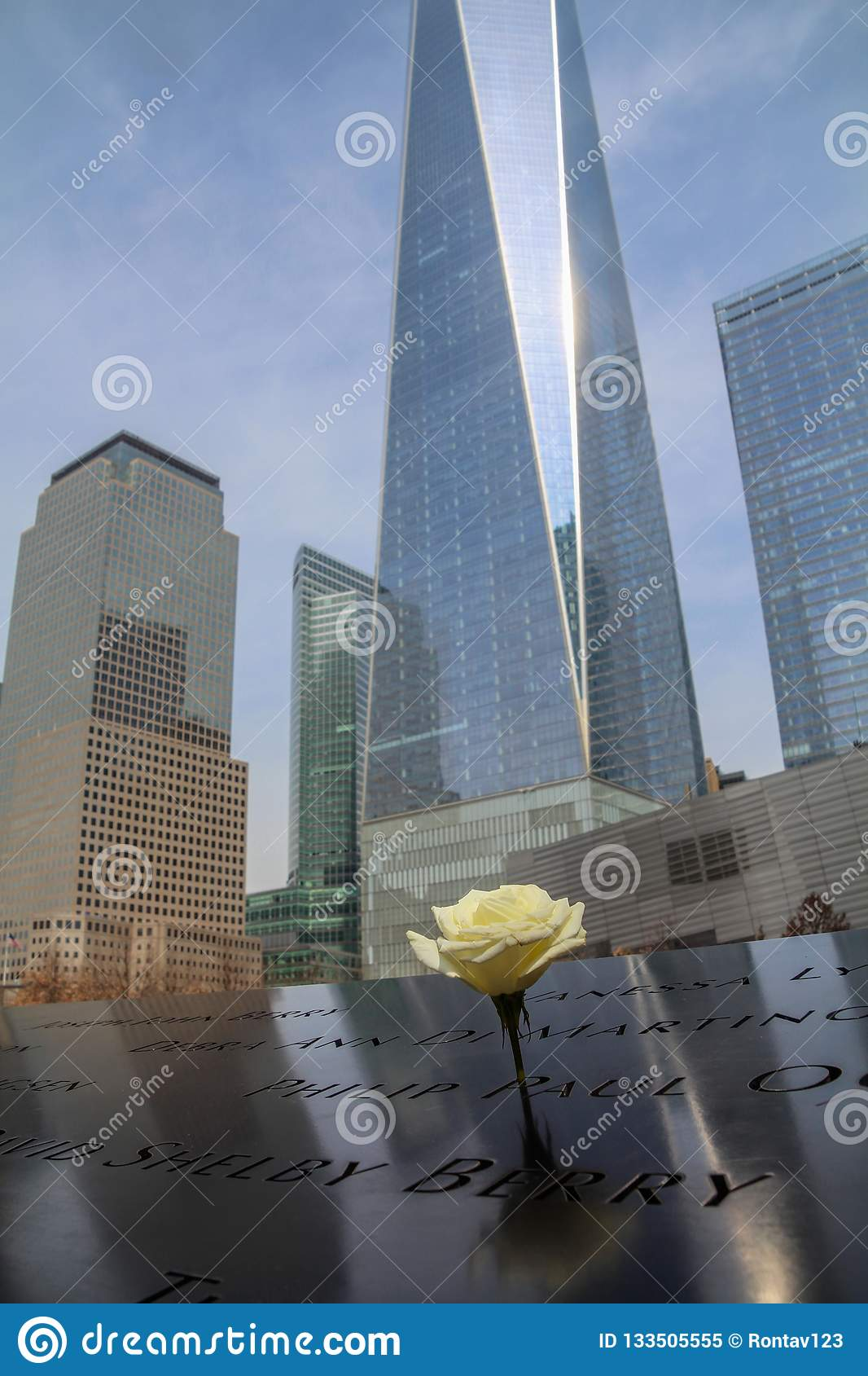 New York City, USA - March 16, 2016: Freedom Tower , One World Trade Center and The September 11 Memorial Pool