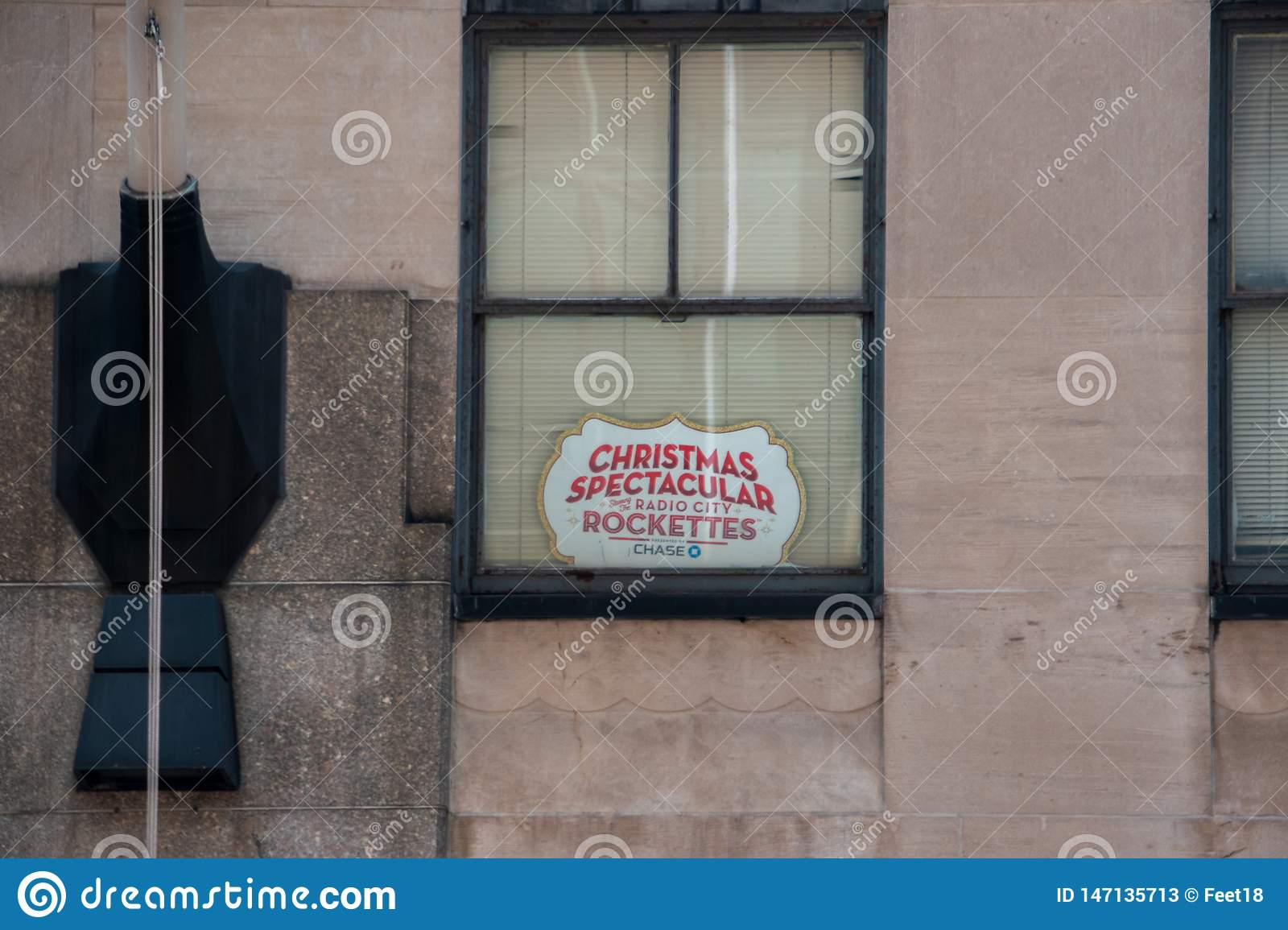 Christmas Music On Radio 2019.Sign In A Window Advertising The Christmas Spectacular Show