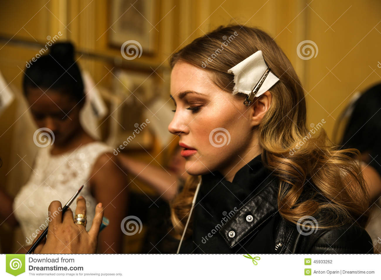 NEW YORK, NY - OCTOBER 09: A model getting ready backstage during Oleg Cassini Fall 2015 Bridal collection