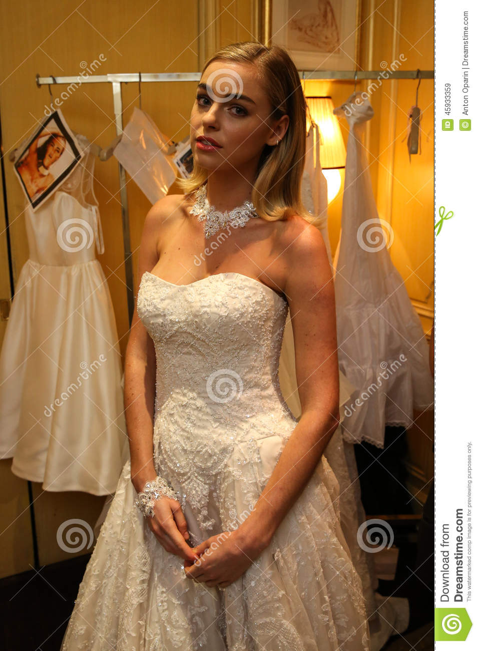 NEW YORK, NY - OCTOBER 09: A model getting ready backstage wearing Oleg Cassini Fall 2015 Bridal collection