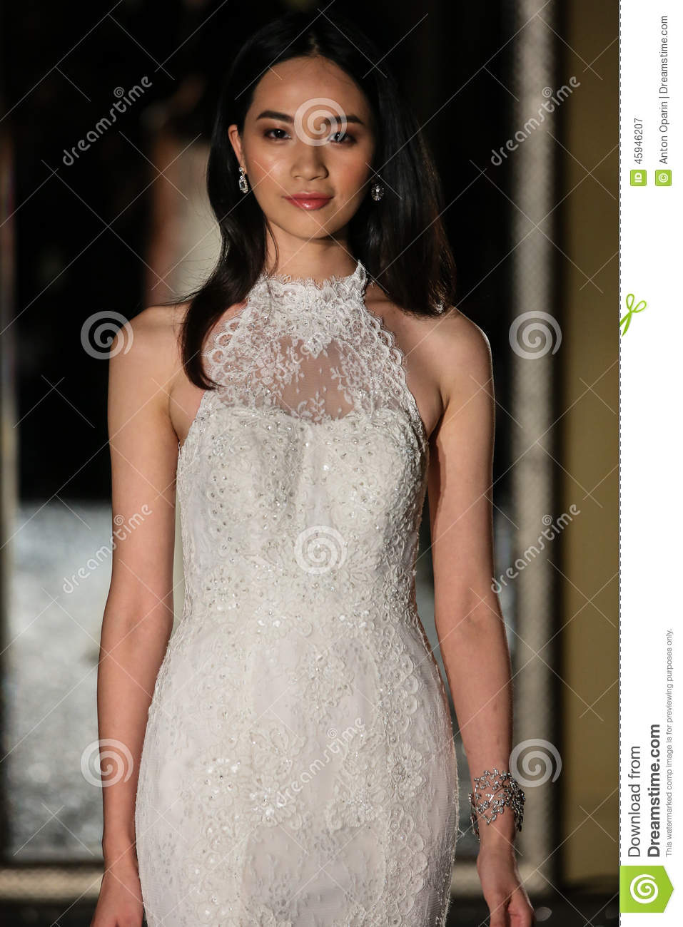 NEW YORK, NY - OCTOBER 09: A model walks the runway wearing Oleg Cassini Fall 2015 Bridal collection