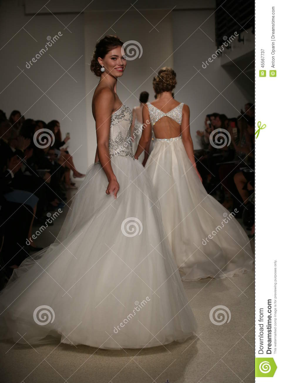 NEW YORK, NY - OCTOBER 10: Models walk the runway finale during the Anne Barge Fall 2015 Bridal Collection