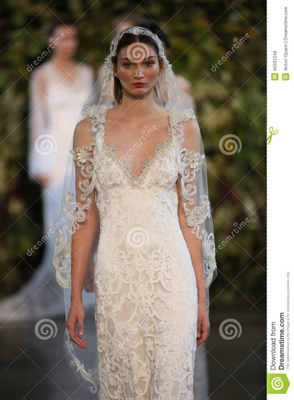 NEW YORK, NY - OCTOBER 10: Models walk the runway finale during the Claire Pettibone Fall 2015 Bridal Collection Show