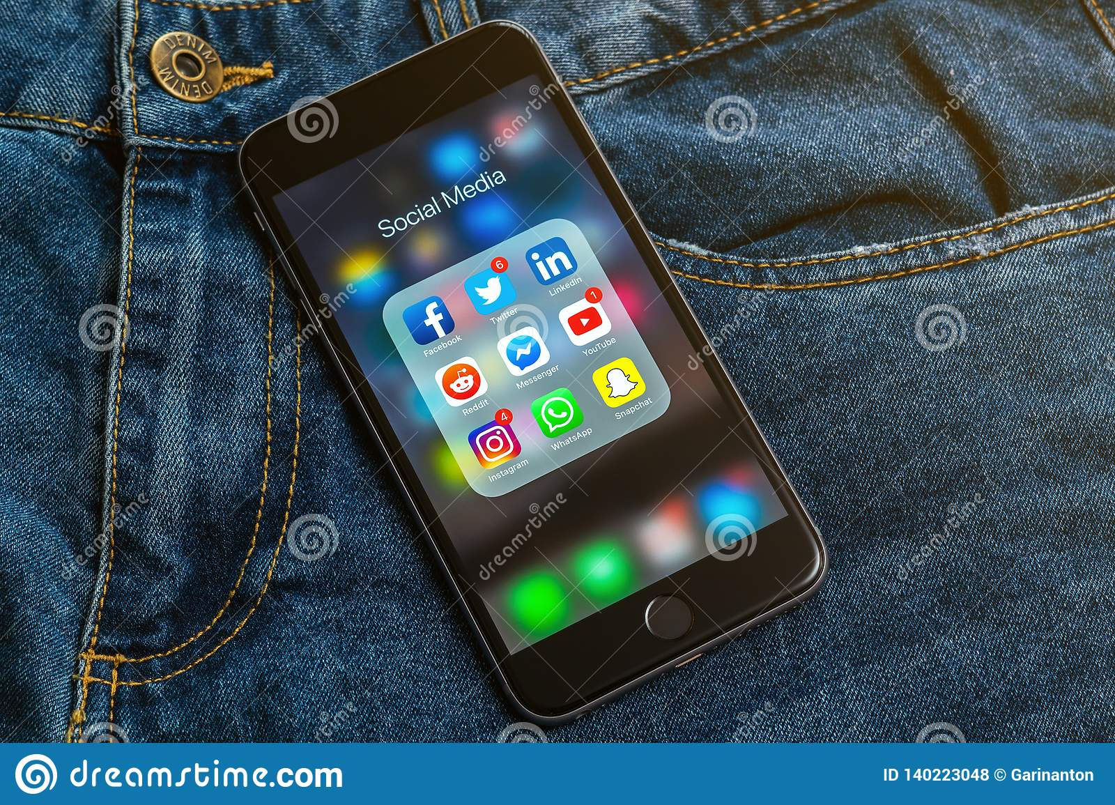 IPhone with icons of social media: instagram, youtube, reddit, facebook, twitter, snapchat, whatsapp applications on screen
