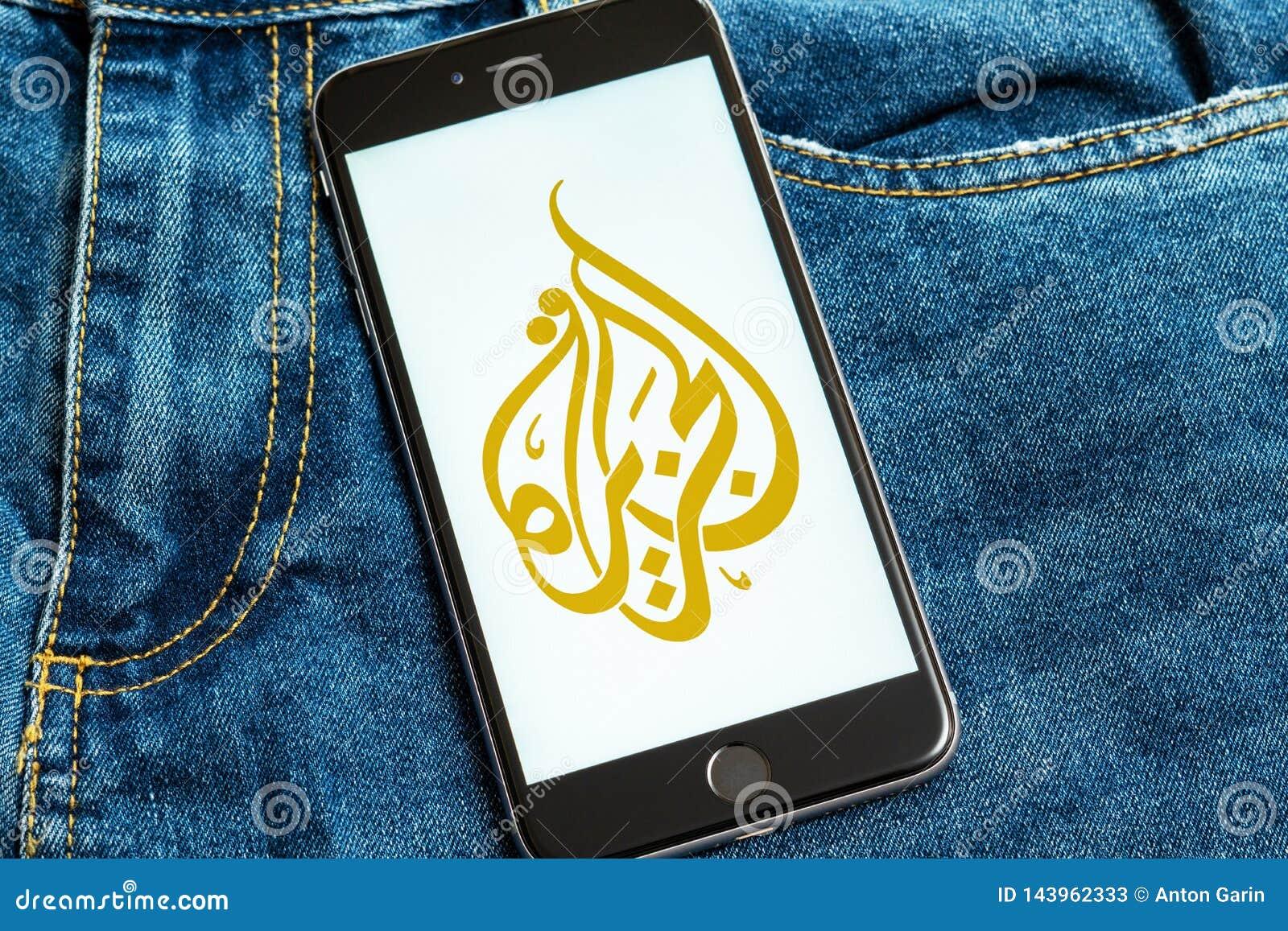 Black phone with logo of news media Al Jazeera on the screen.