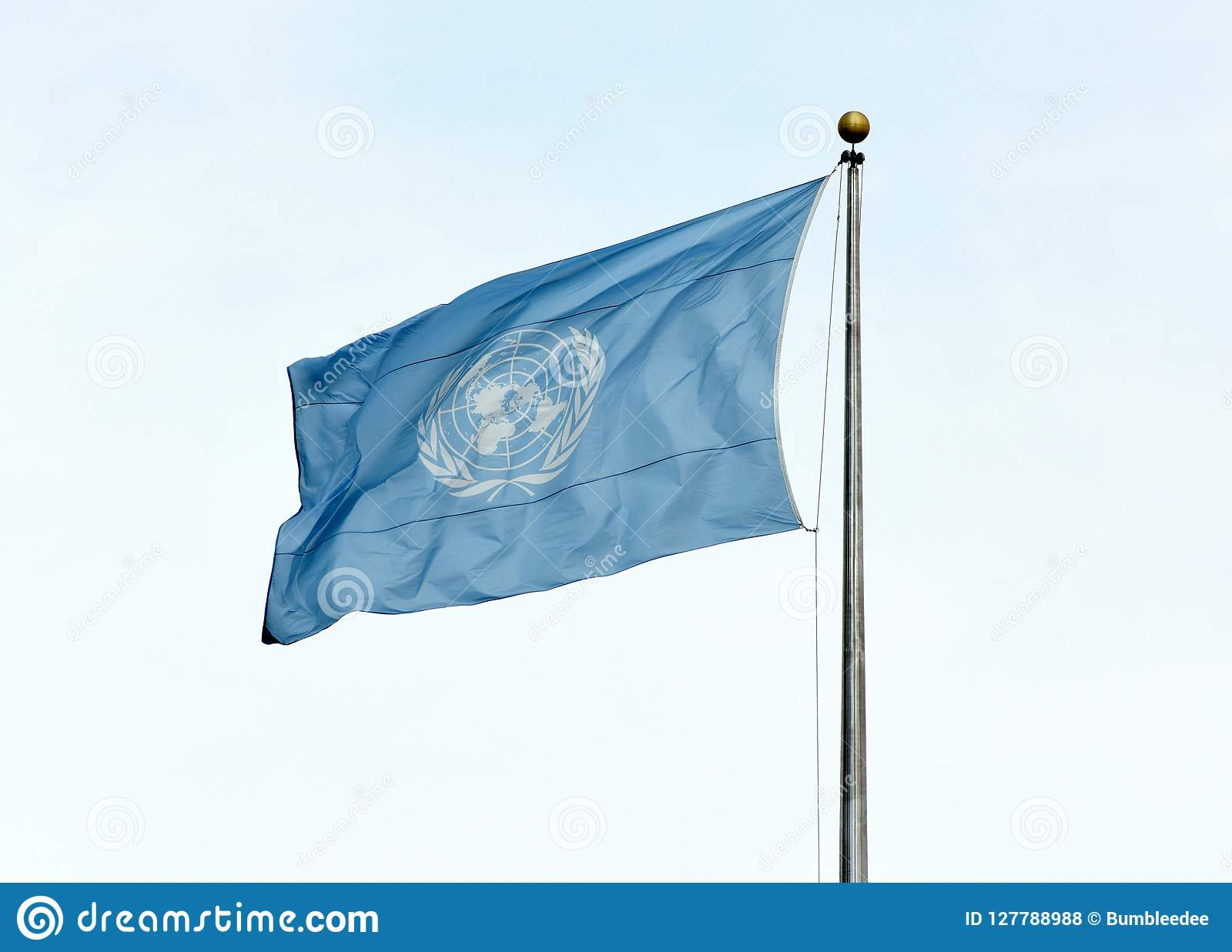 NEW YORK, USA - May 26, 2018: UN Flag Waving In The Sky Near