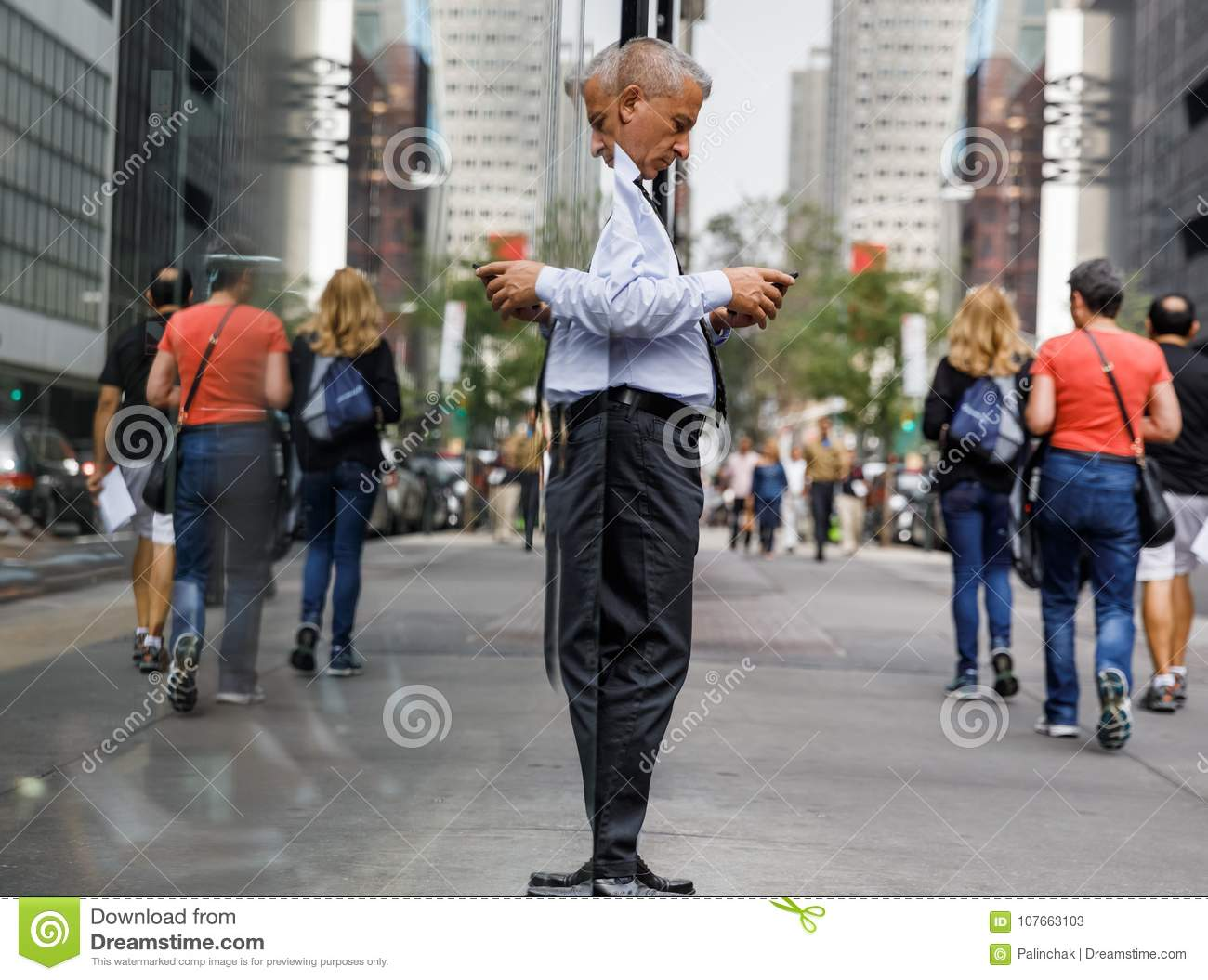 Elderly gray-haired man with a mobile phone in NYC