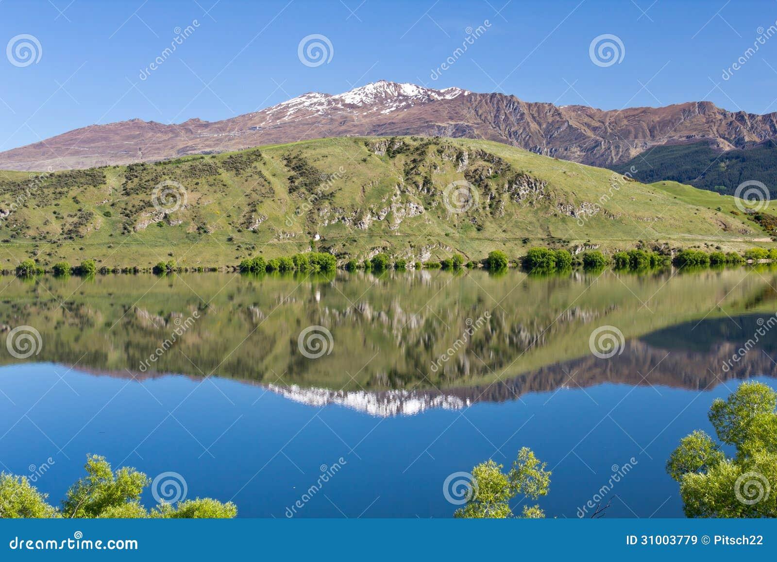 New Zealand Time Image: New Zealand, Lake Hayes With Coronet Peak Royalty Free
