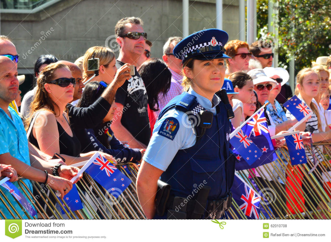 ... Woman Guarding Crowd Of People Editorial Stock Photo - Image: 62010708
