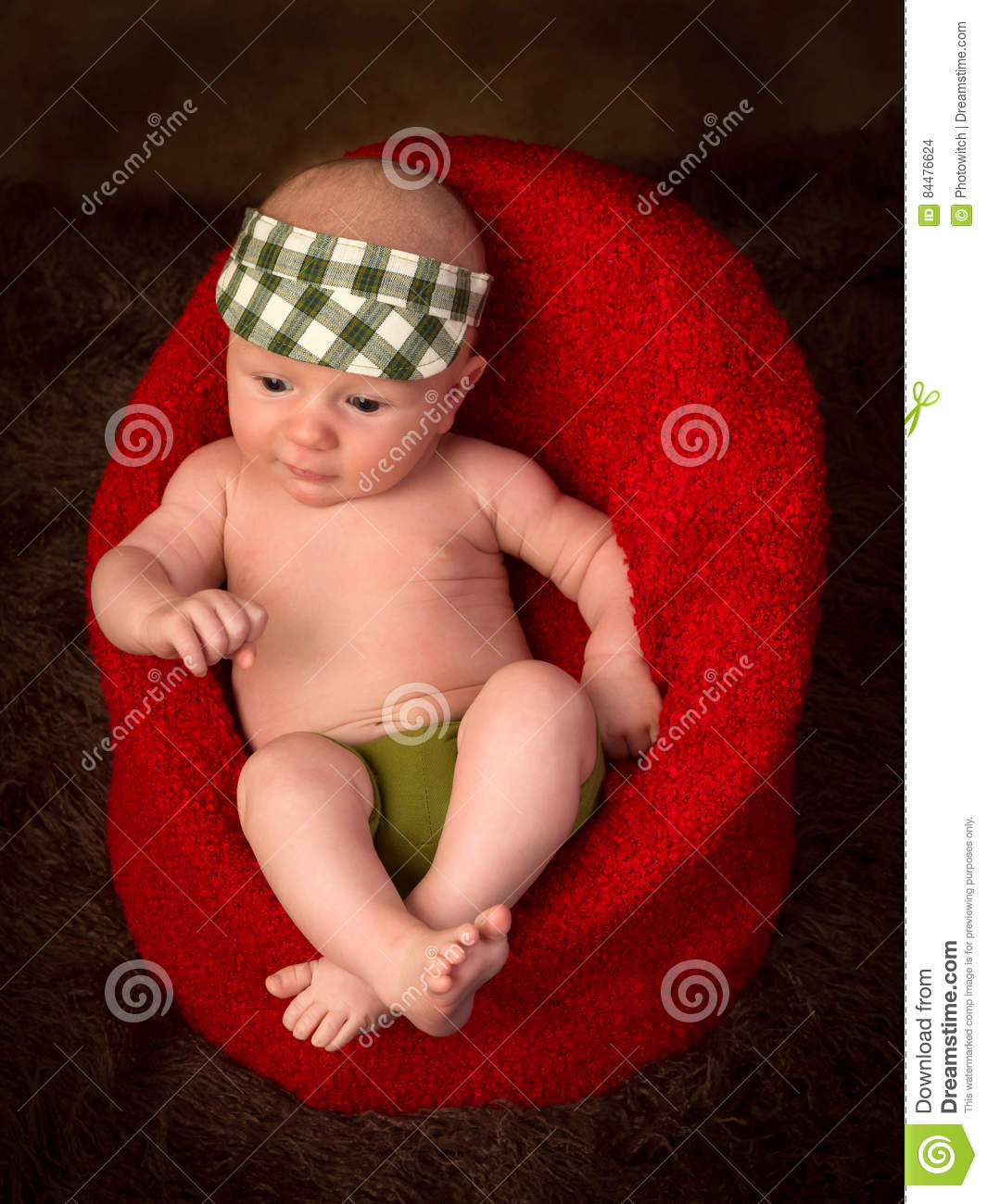 Newborn baby in armchair stock photo. Image of ...
