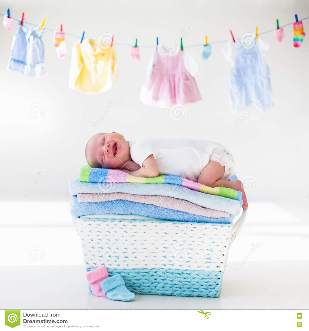 Newborn Baby In A Basket With Towels Stock Photo Image