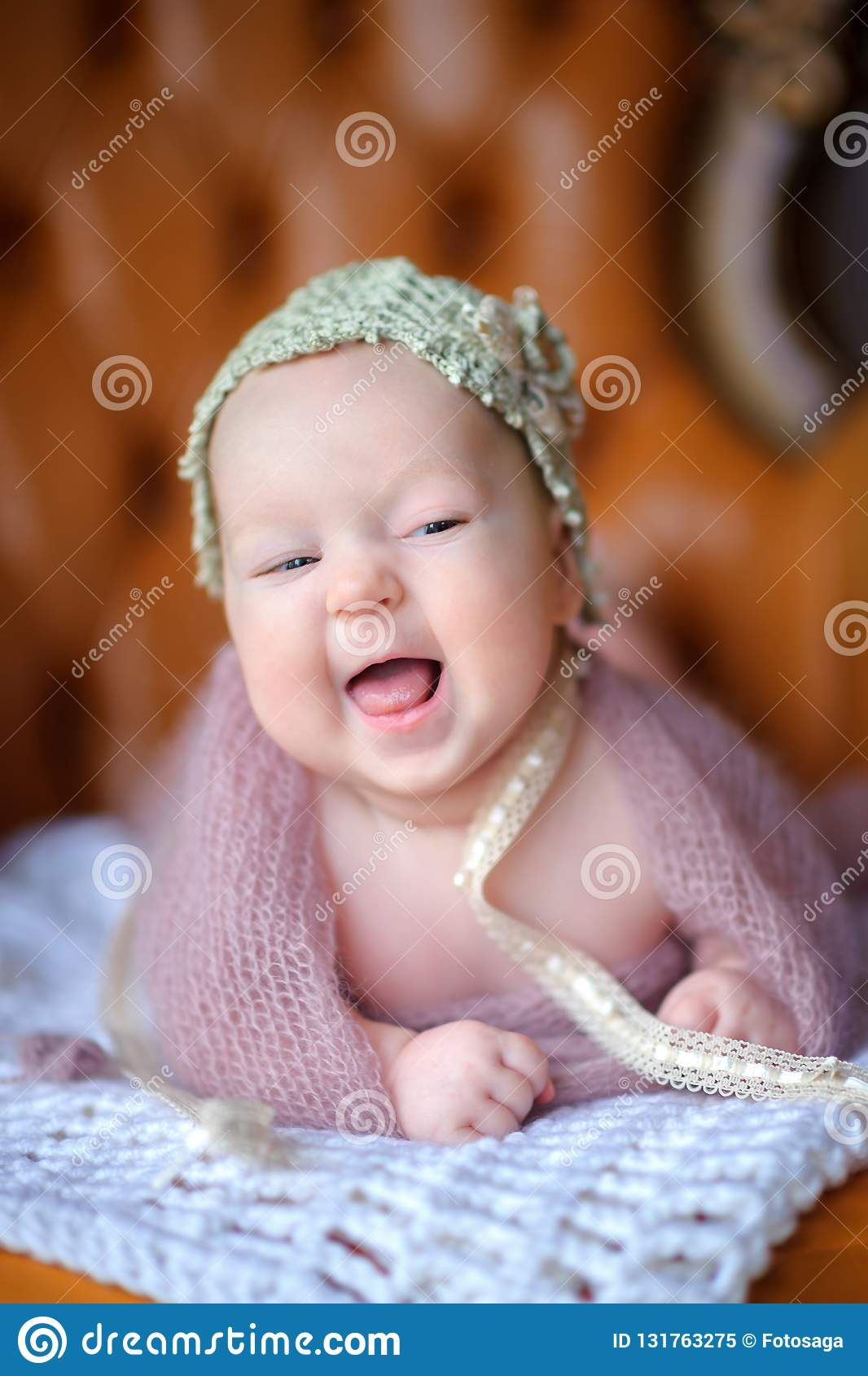 Newborn baby in a beautiful knitted hat