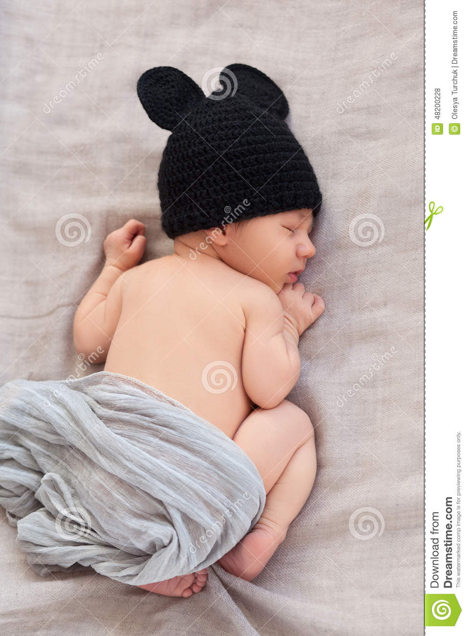Newborn baby in black mouse hat