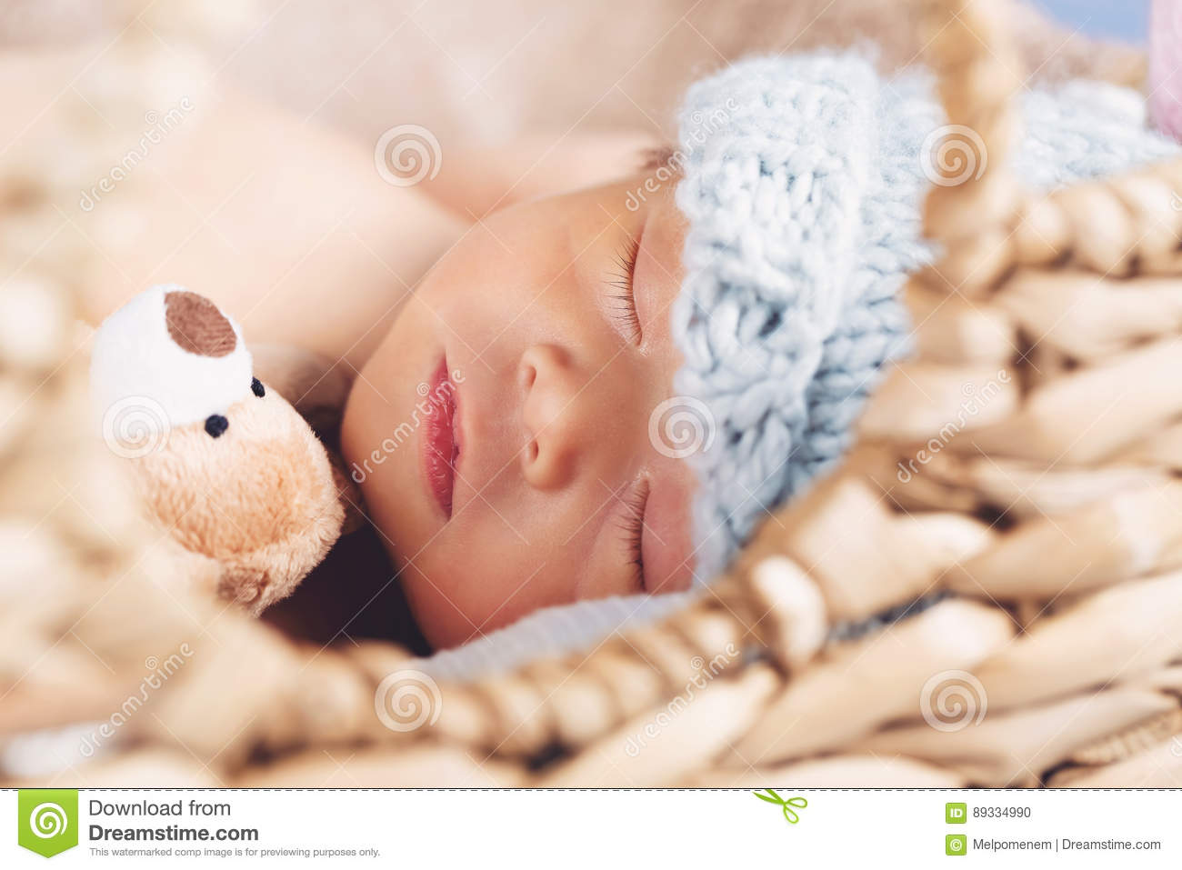 Newborn baby boy in a basket