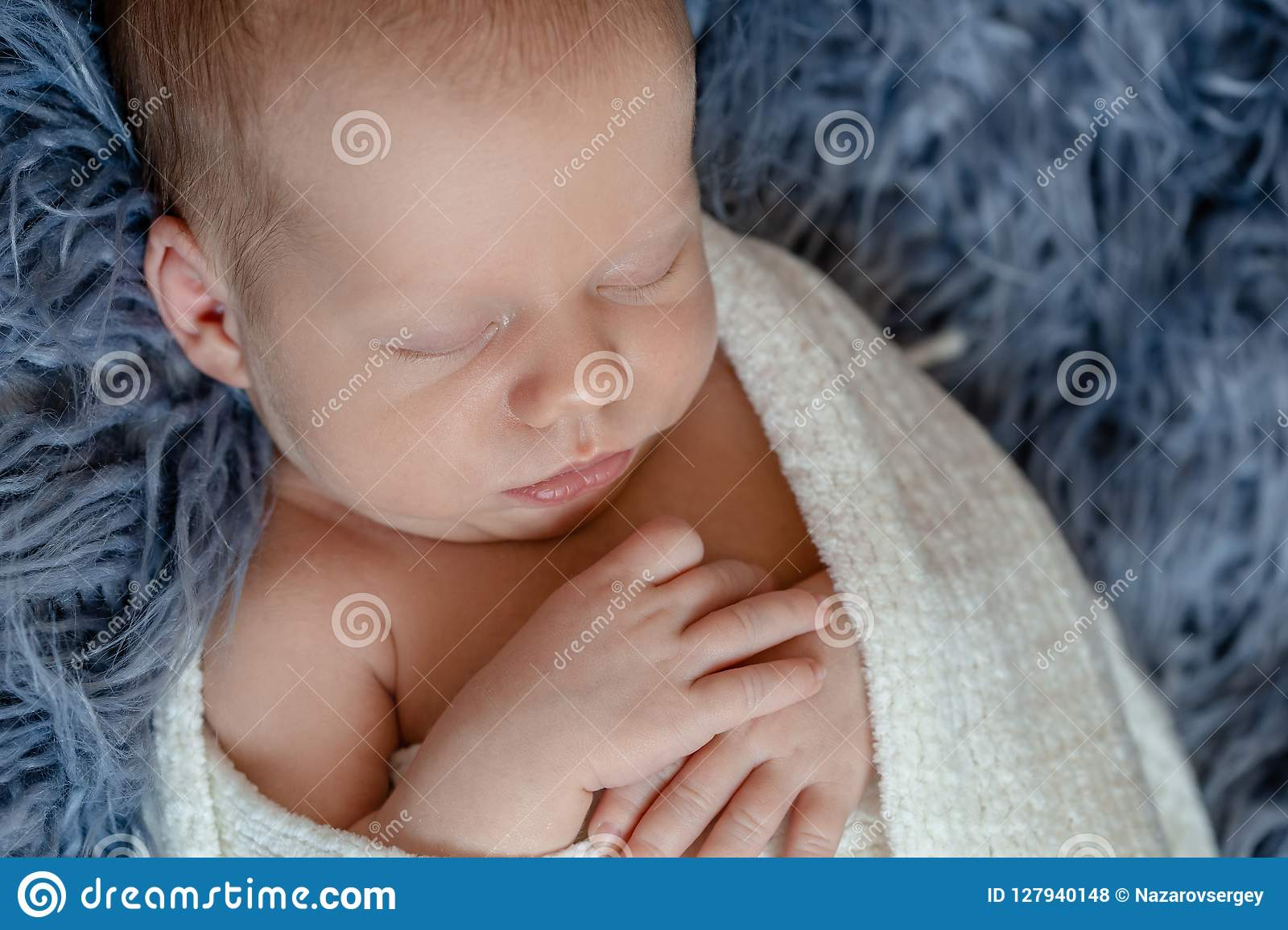 58c818333880 Newborn Baby Boy In Bed. New Born Child Sleeping Under A White ...