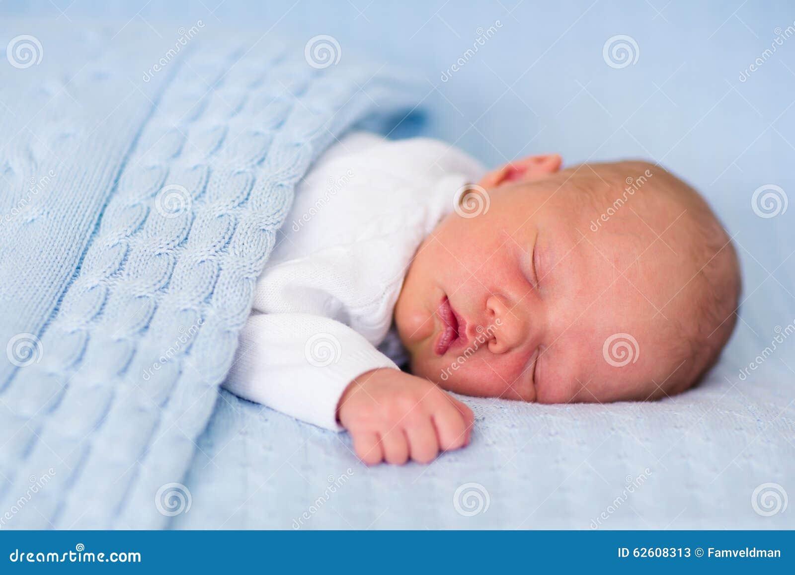 2c35995aab8b Newborn Baby Boy On A Blue Blanket Stock Image - Image of little ...