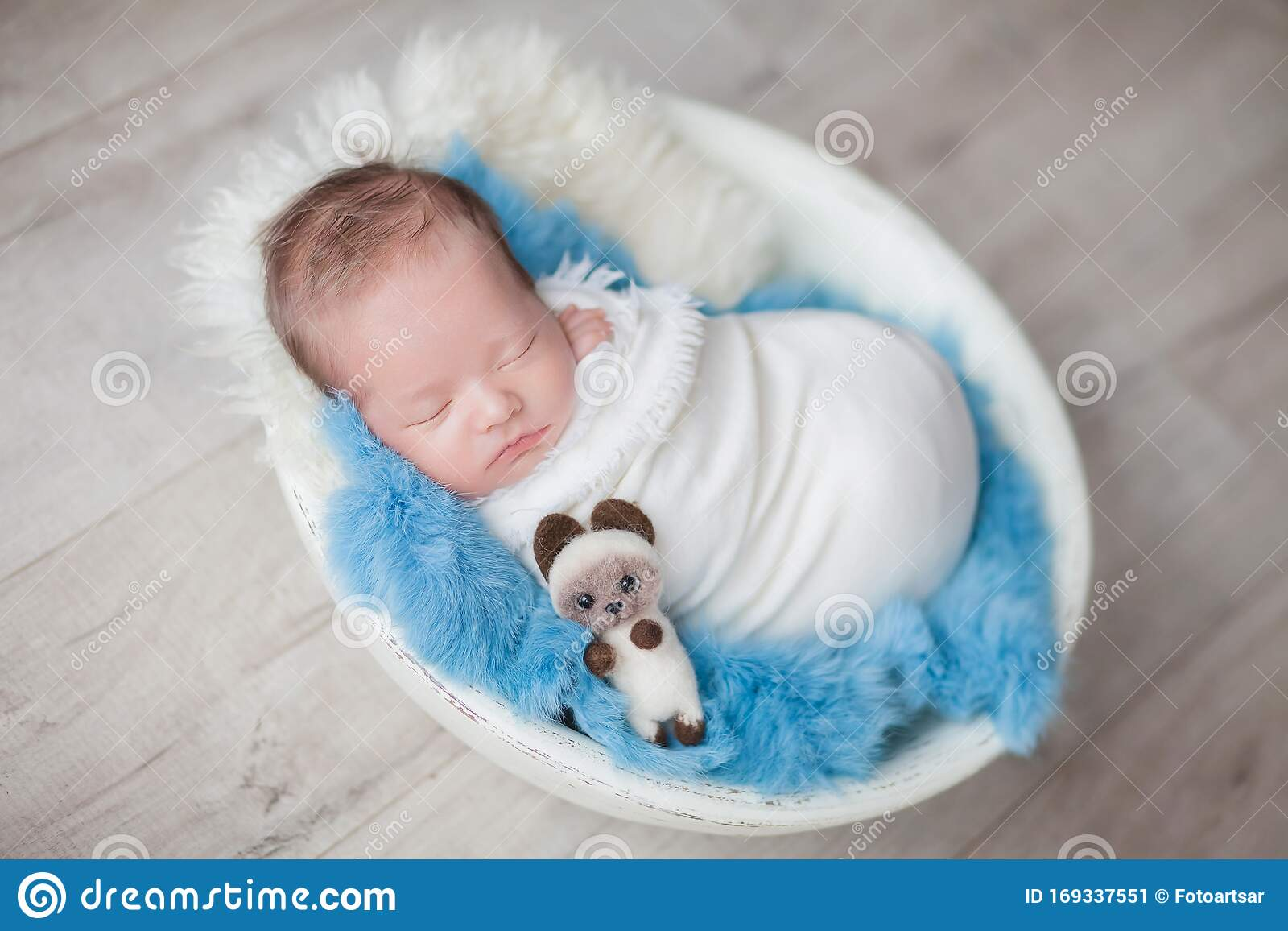 Picture of: Newborn Baby Boy In A Cocoon In A White Bowl On A Blue Rug Stock Image Image Of Sweet Newborn 169337551