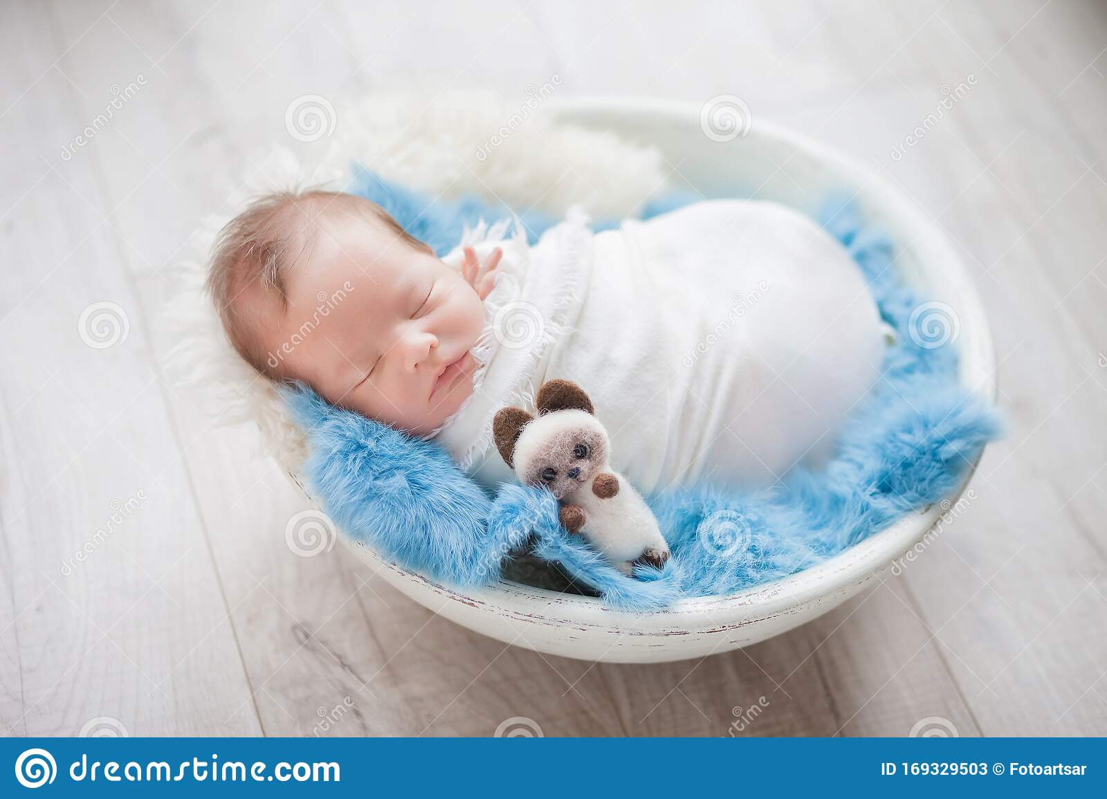 Picture of: Newborn Baby Boy In A Cocoon In A White Bowl On A Blue Rug Stock Image Image Of Caucasian Little 169329503