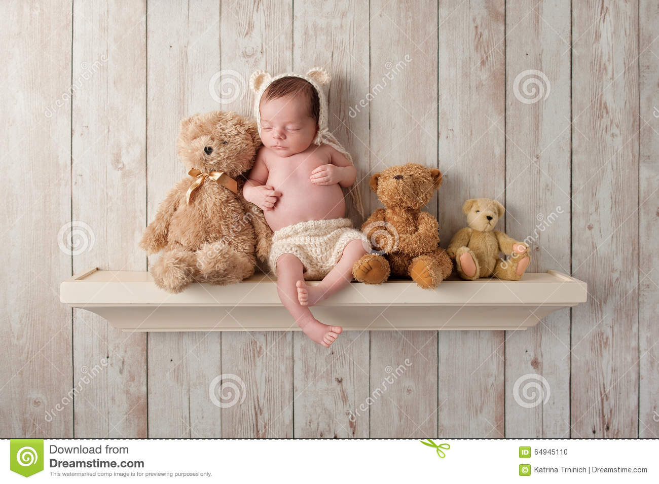 Three week old newborn baby boy wearing a cream colored crocheted bear ...