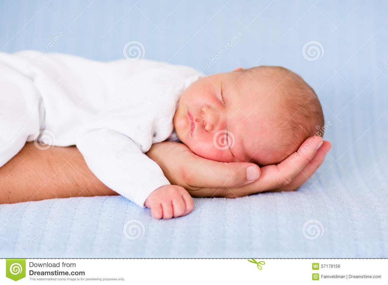 Newborn Baby Boy Sleeping On The Hand Of His Father Stock
