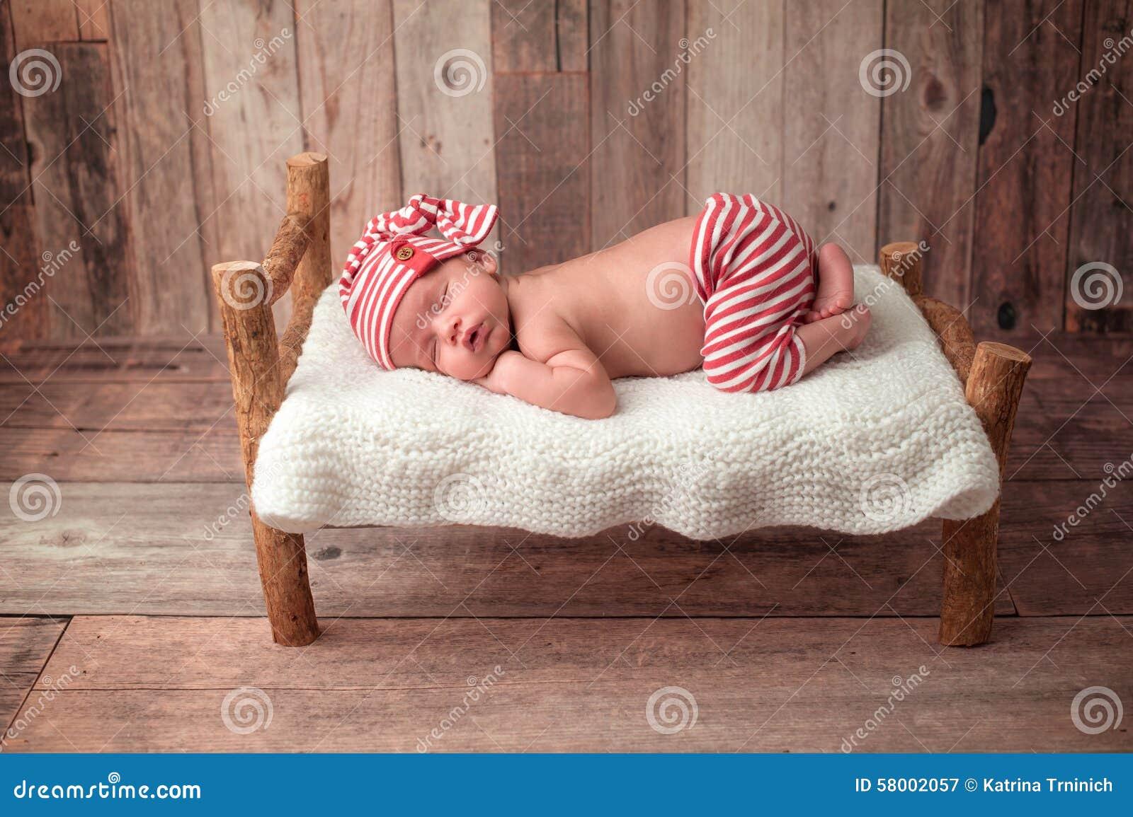 Tiny Bed newborn baby boy sleeping on a tiny bed stock photo - image: 58002057