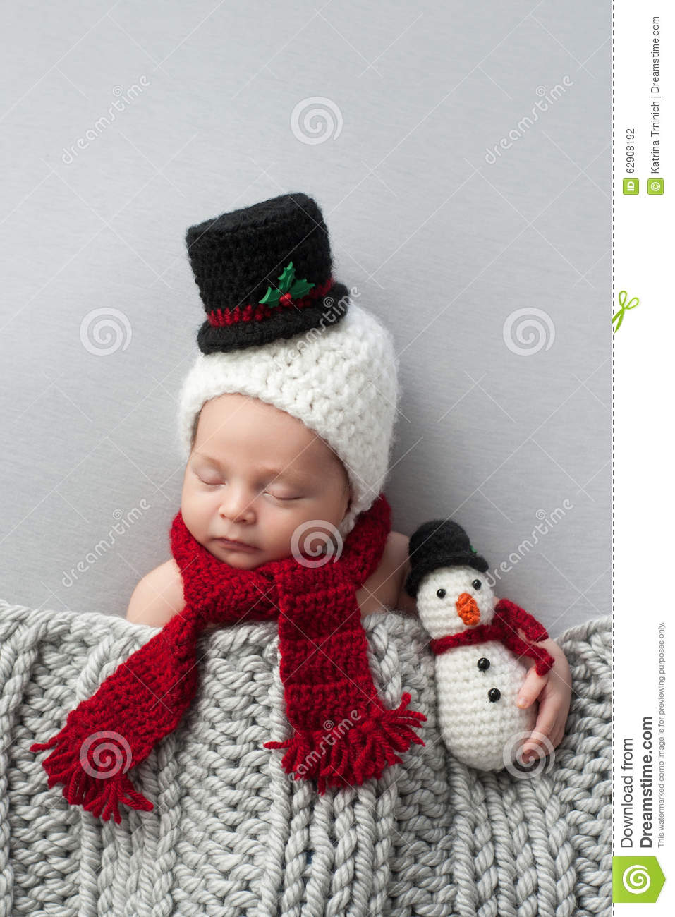 Newborn Baby Boy With Snowman Hat And Plush Toy Stock