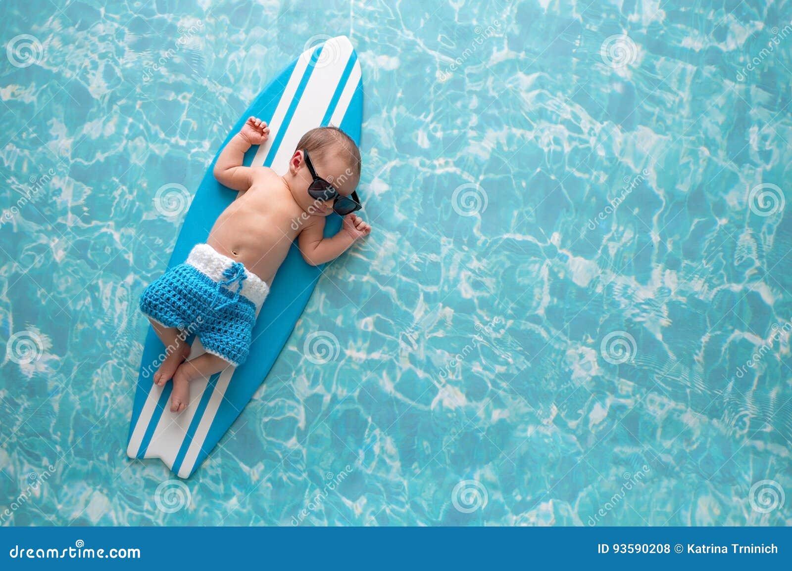 70877f72d Newborn Baby Boy On Surfboard Stock Photo - Image of bathing