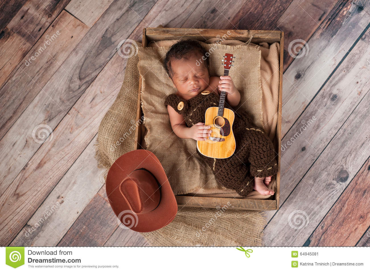 Newborn Baby Cowboy Playing A Tiny Guitar Stock Photo
