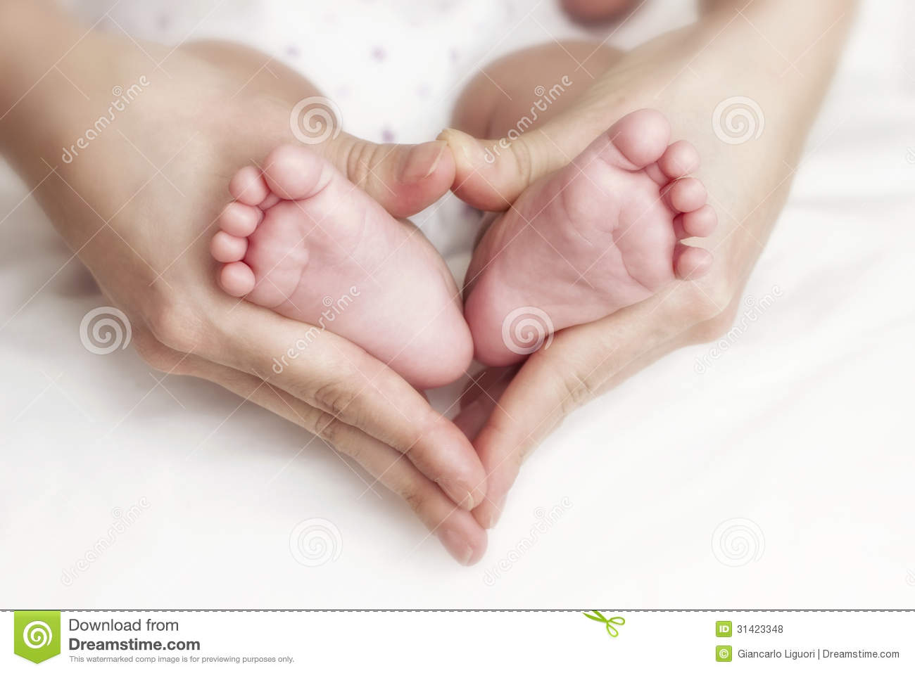 Newborn Baby Feet In The Mother Hands Royalty Free Stock Photos