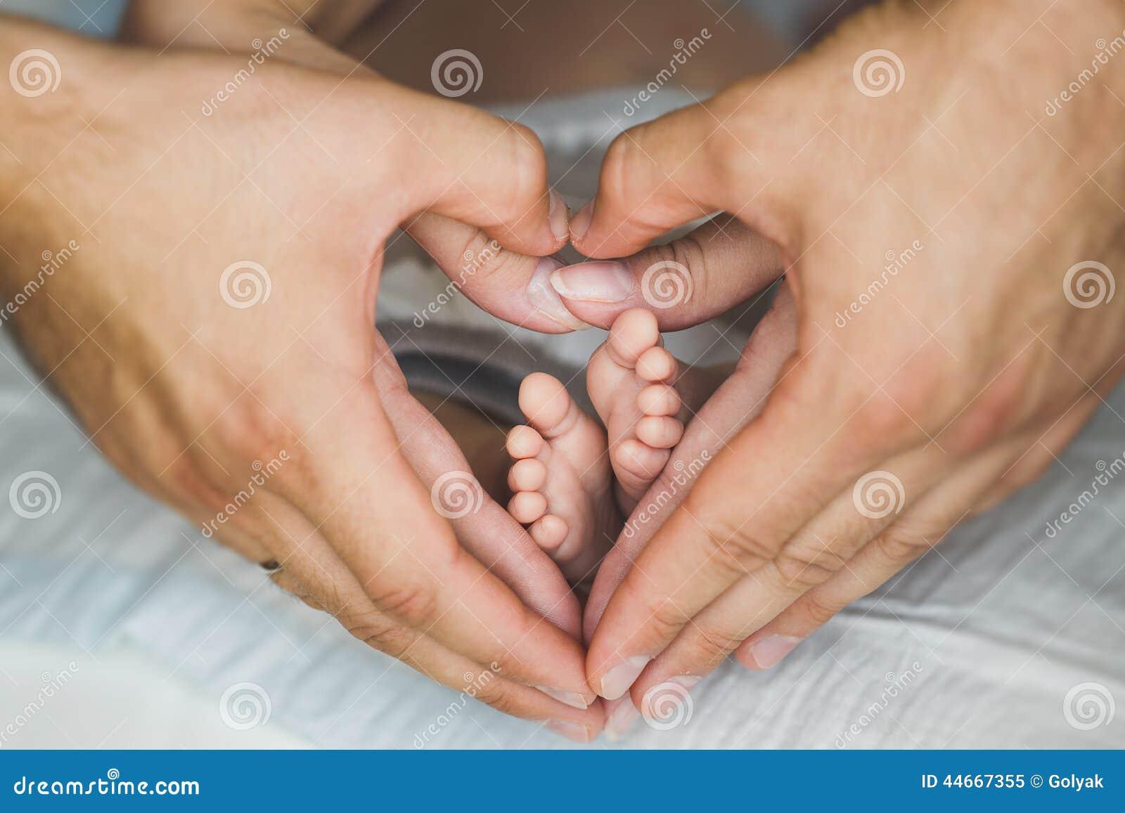 Baby Foot De Salon newborn baby feet in mother hands. stock image - image of