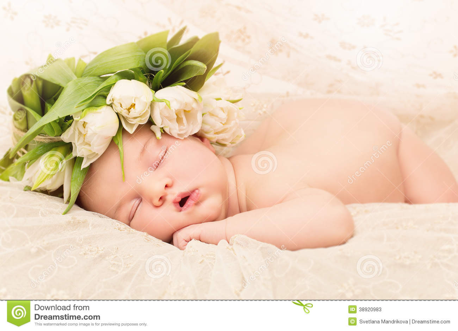 Newborn Baby With Flowers Stock Photo
