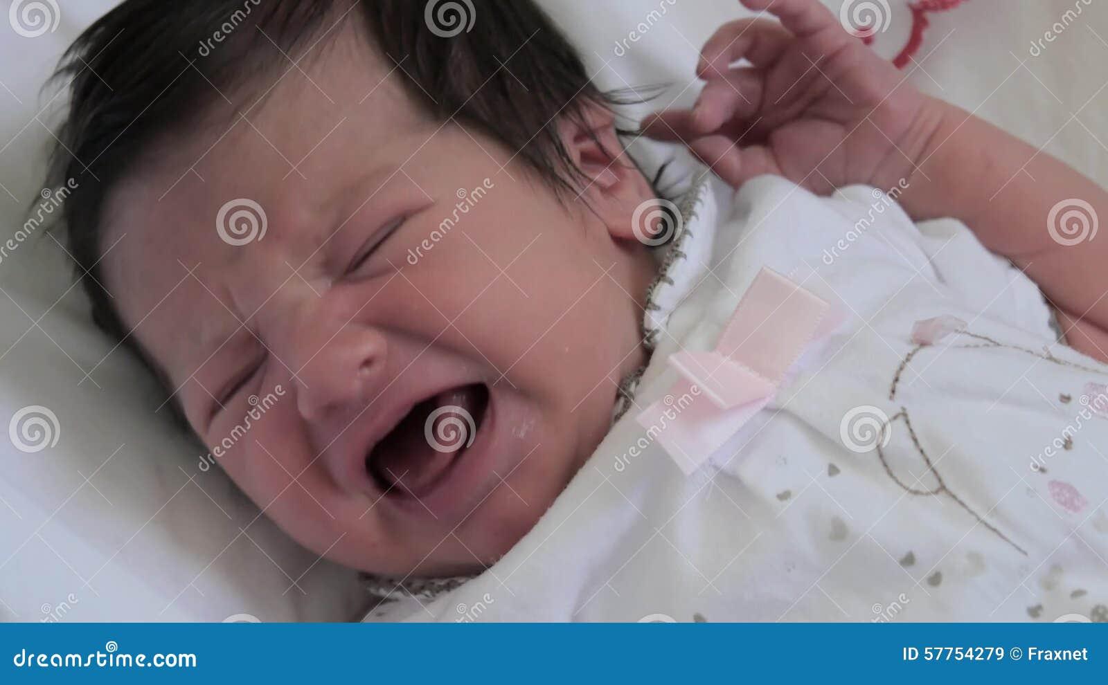 Newborn baby girl crying stock video
