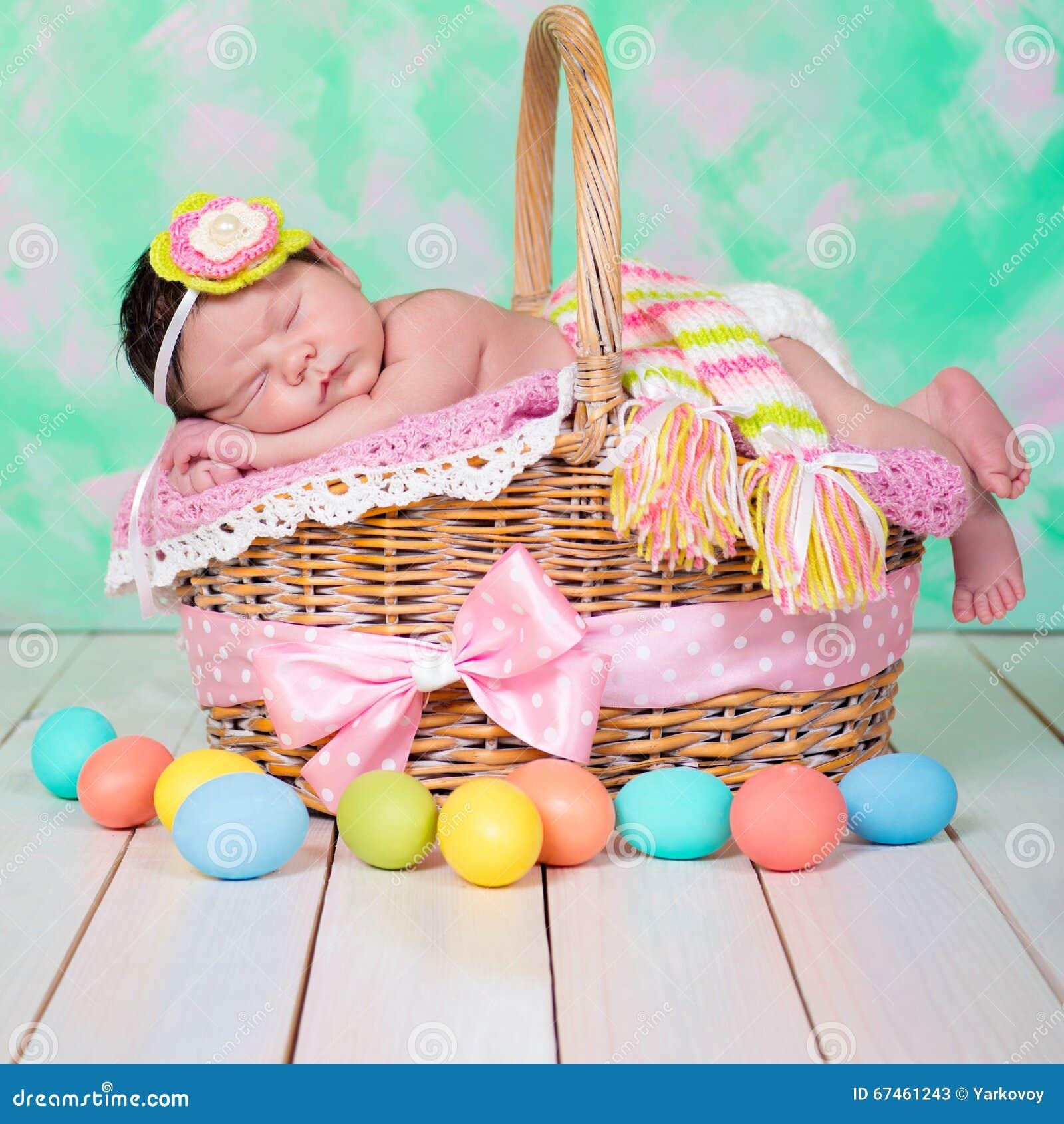 Newborn baby girl has sweet dreams on the wicker basket easter newborn baby girl has sweet dreams on the wicker basket easter holiday negle Gallery