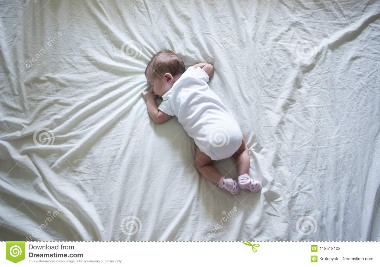 200127b1d Newborn Baby Girl Lying On Her Stomach Stock Photo - Image of little ...