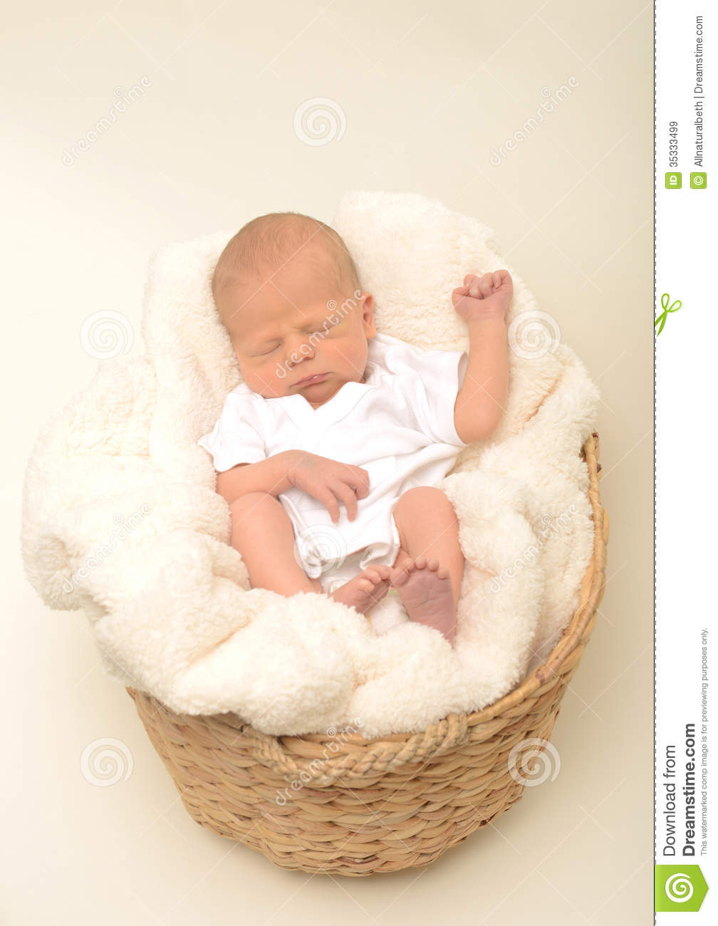 Newborn Baby Or Infant Sleeping In Basket Royalty Free