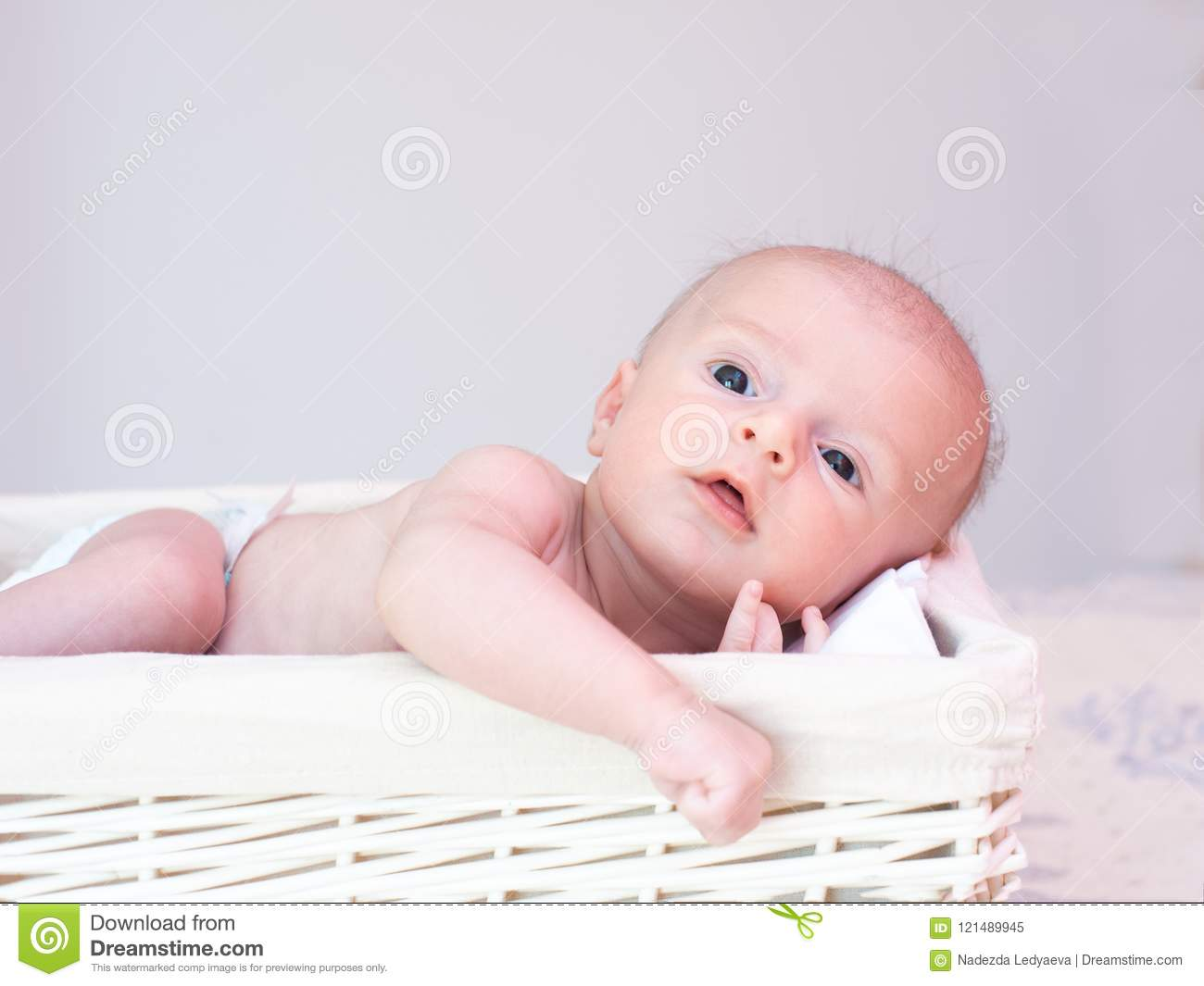 Newborn Baby Lies In A Basket With Open Eyes Stock Image ...