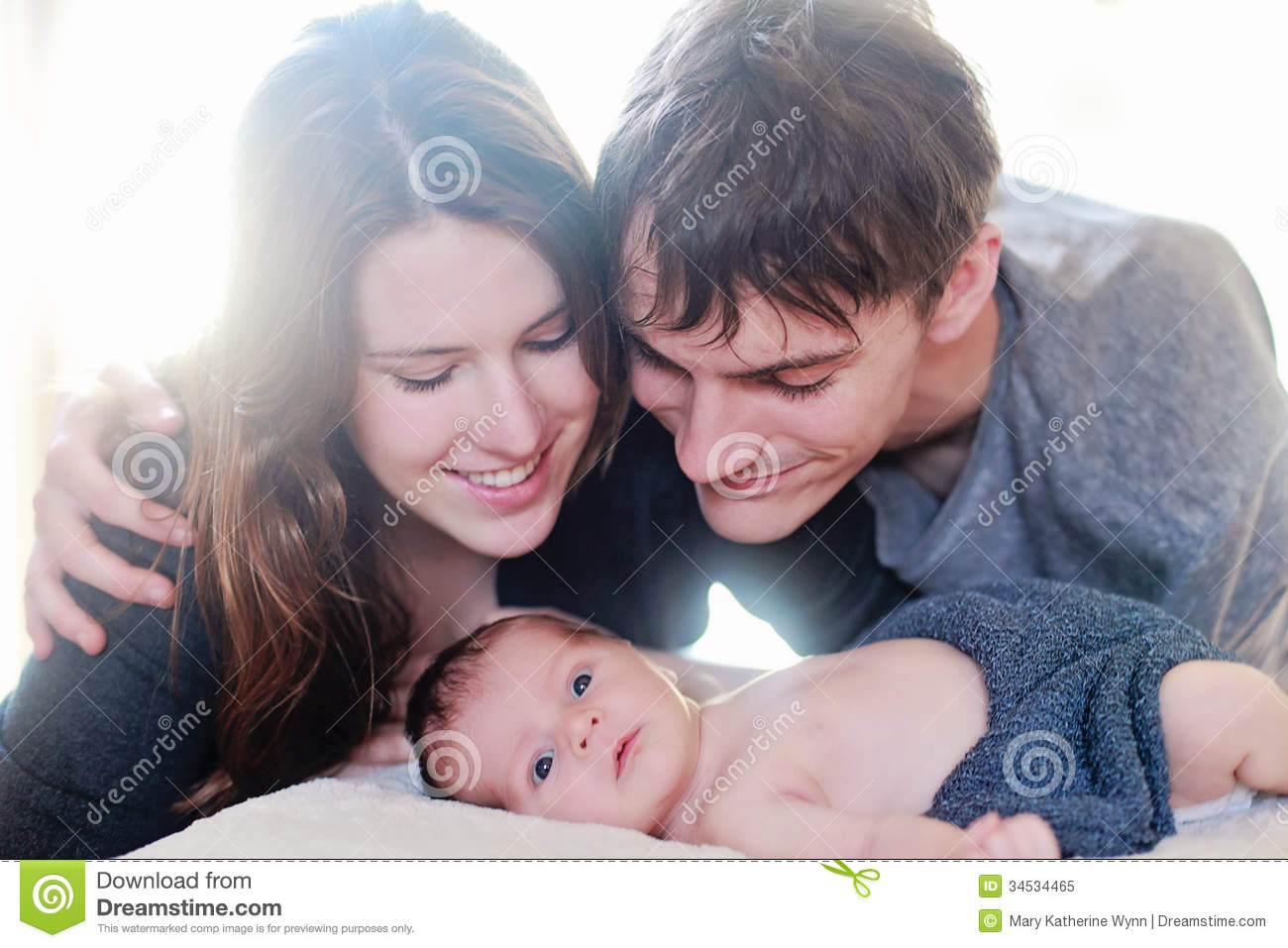 Newborn baby meeting parents