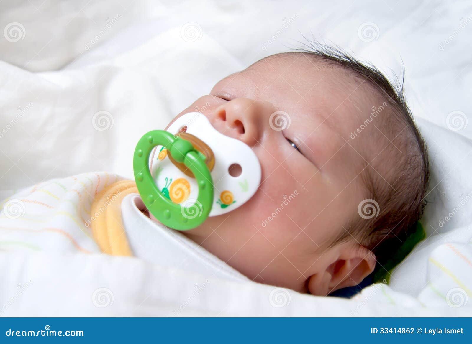 Newborn Baby With Pacifier Sleeping Stock Photo Image