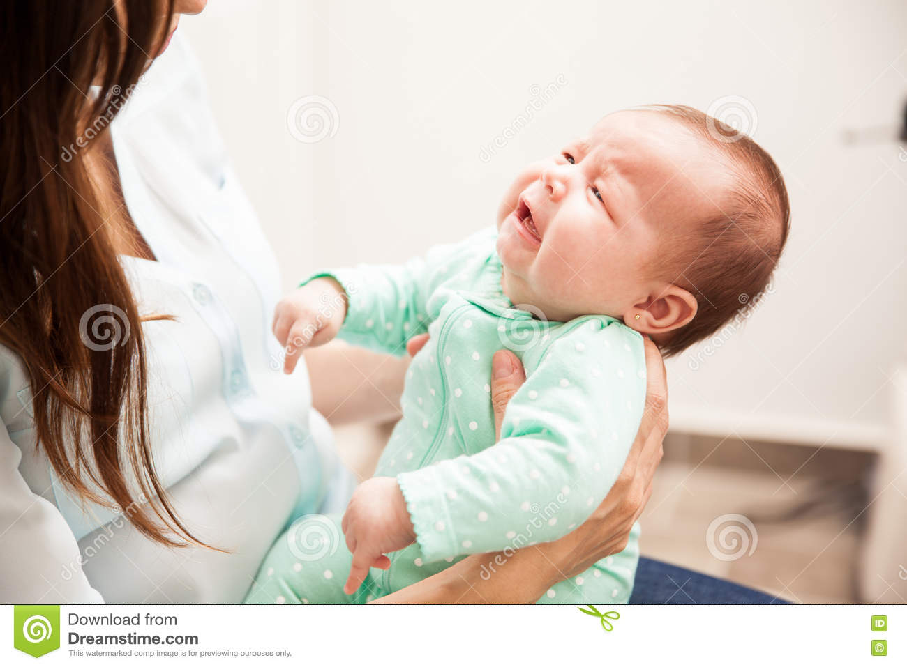 Newborn baby pouting to her mother