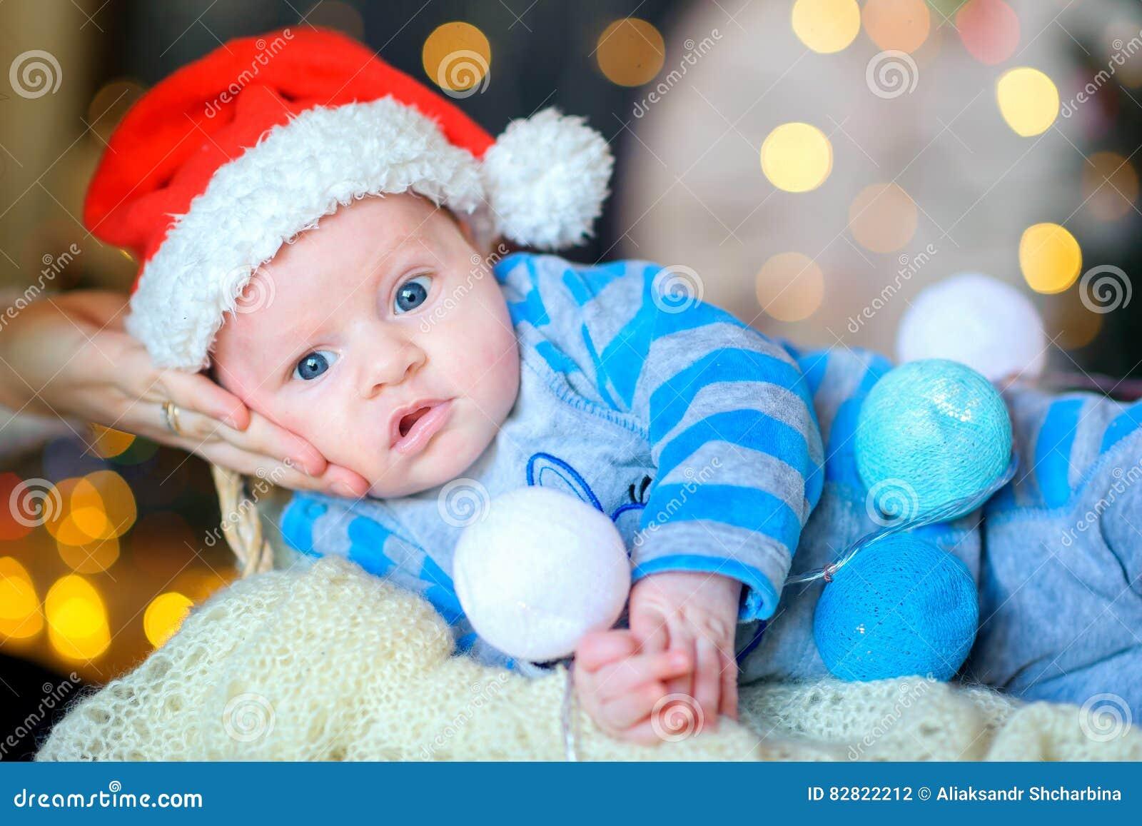 26813de03b5 Newborn Baby In Santa Claus`s Cap Stock Photo - Image of beautiful ...